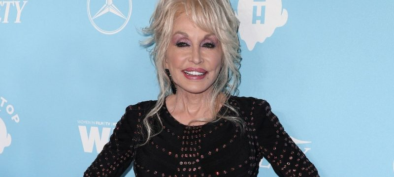 Dolly Parton Reacts to News That Her $1 Million Donation Helped Fund a COVID-19 Vaccine